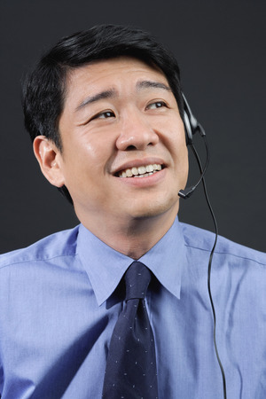 hands free: Businessman using hands free device