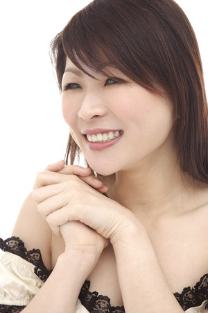 dimple: Woman, smiling, looking away, hands clasped
