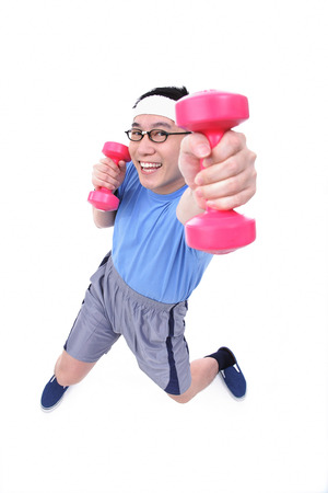 Man using dumbbells, high angle view