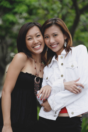 Two women smiling at camera Stock Photo