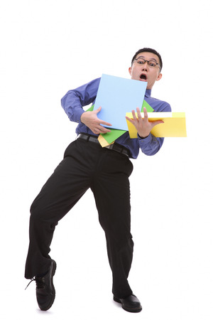 carrying: Clumsy businessman carrying folders