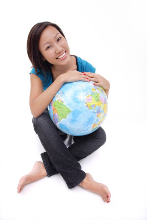 Woman holding globe, sitting cross-legged
