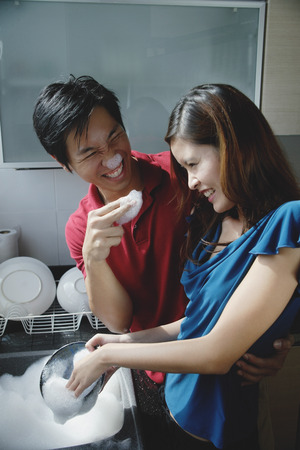suds: Couple washing dishes, playing with soap suds