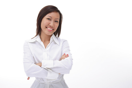 Woman with arms crossed, smiling at camera Stock Photo