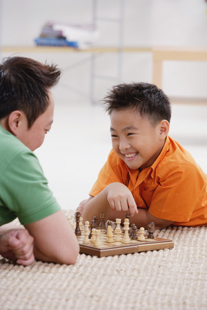 9 10 years: Father and son playing chess
