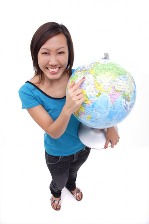 world at your fingertips: Woman holding globe, smiling at camera