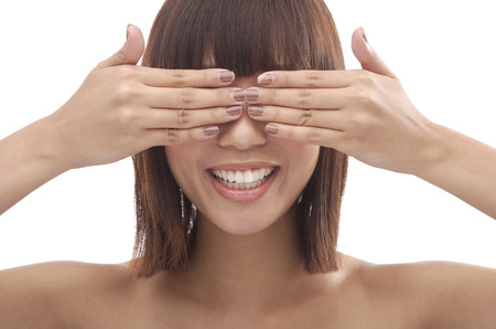covering eyes: Young woman with hands covering eyes