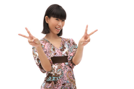 Young woman making peace sign with fingers