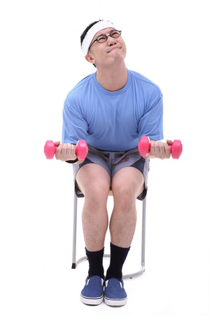 Man sitting on stool, lifting weights