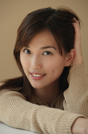 only 1 person: Young woman smiling at camera