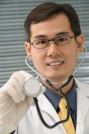 Doctor with stethoscope smiling at camera