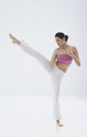 Woman kick boxing, martial arts,