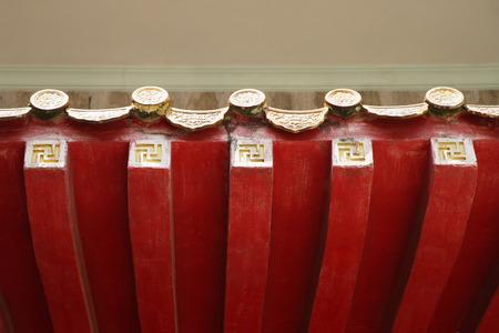 sanskrit: Detail of carving on Chinese temple roof overhang (Sanskrit Swastika symbol meaning auspicious)