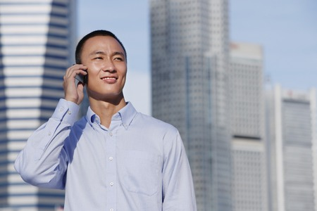 only 1 person: A man talks on his cellphone outdoors