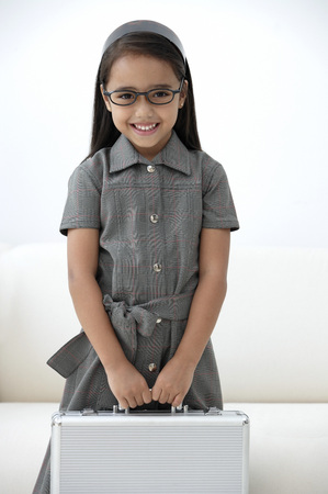 one room school house: A young girl dressed in school uniform with glasses LANG_EVOIMAGES