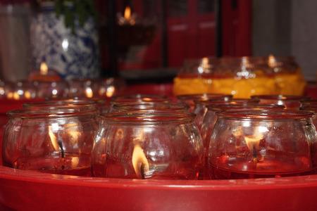 Close up of candles at temple altar 版權商用圖片