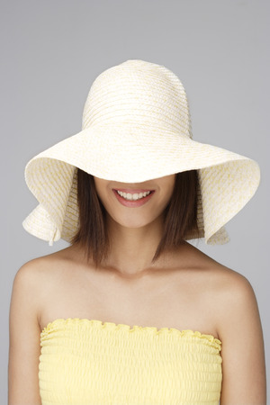 Young woman with big sun hat