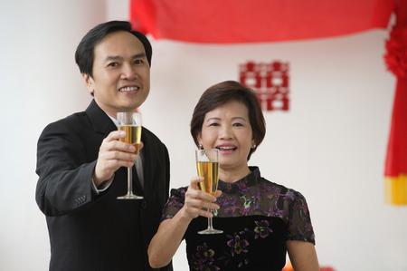 wedding customs: A couple raise their glasses for a toast