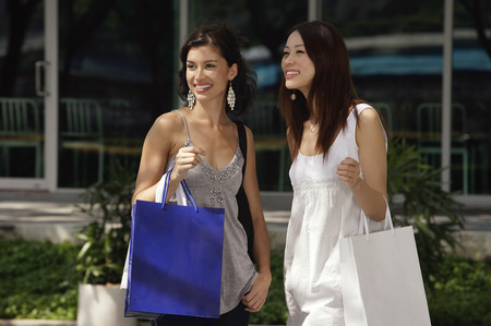 Women with shopping bags looking into the distance