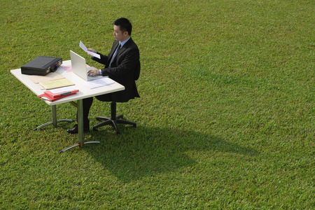 only 1 person: Businessman working at desk