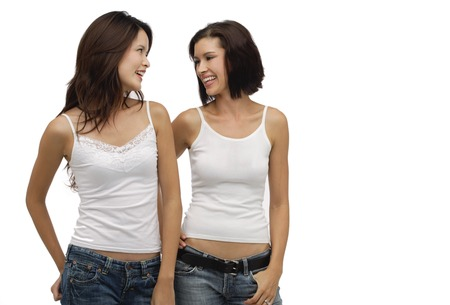 Two young women standing together and looking at each other Stock Photo
