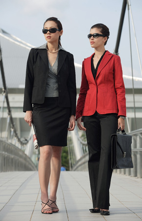 Two businesswomen looking into distance