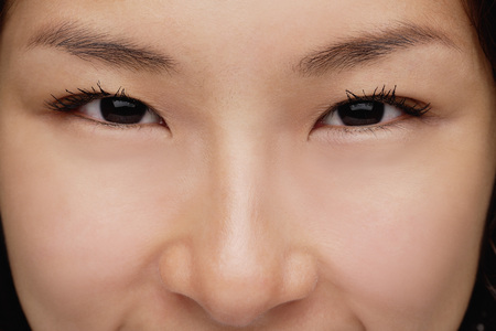 A close-up of a young woman looking at the camera