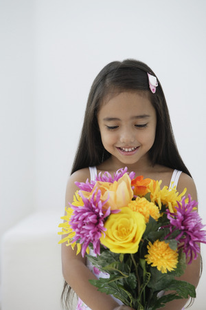 only 1 person: A young girl with a bunch of flowers
