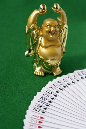 hope indoors luck: Cards and a lucky Buddha