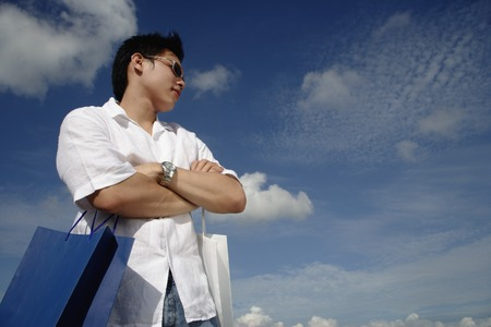 A young man with shopping bags LANG_EVOIMAGES