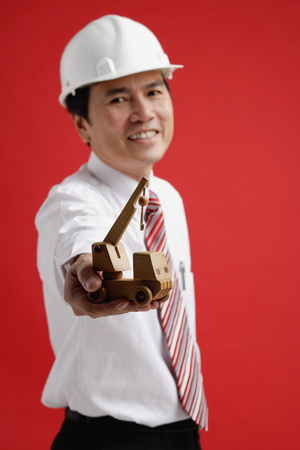 A man wearing a shirt and tie with a hardhat