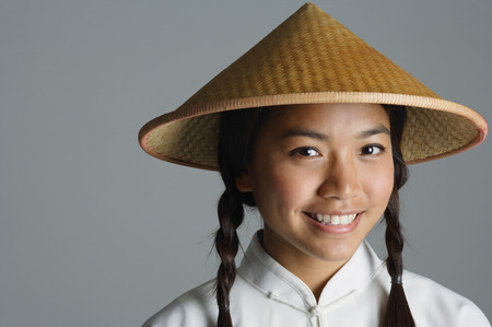 only 1 person: Young woman in traditional Chinese dress smiling at camera