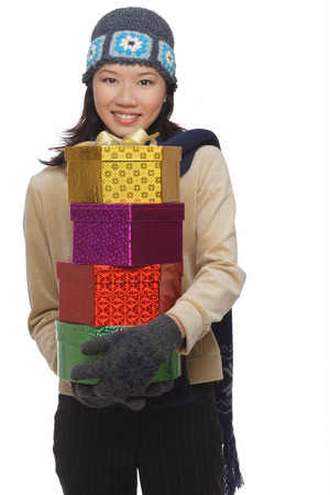 generosa: Young woman with gift boxes, smiling at camera