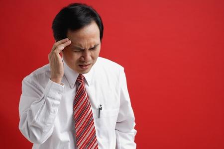 professionally: A man with a headache