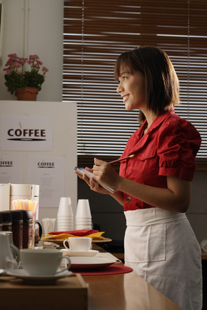 writing western: Waitress in diner taking order