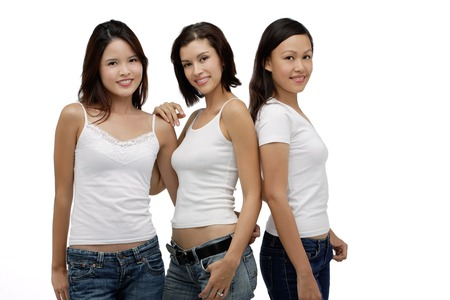 Three Young women standing and looking at camera, smiling