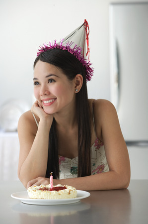 Young woman with cake smiling