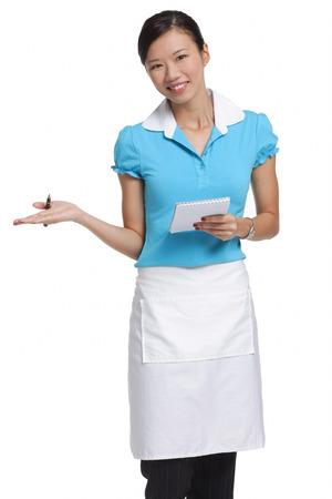 Waitress smiling at camera, holding notepad