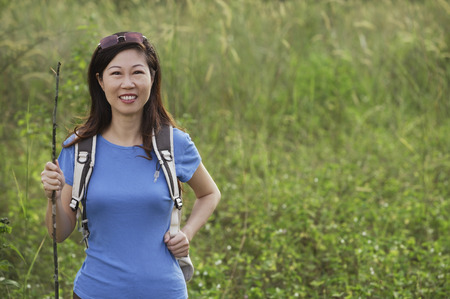 Woman hiking in nature, outdoors Stock Photo