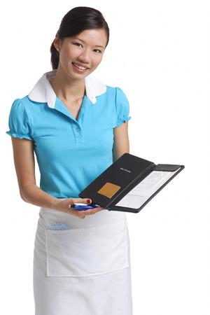 Waitress presents bill, smiling at camera Stock Photo