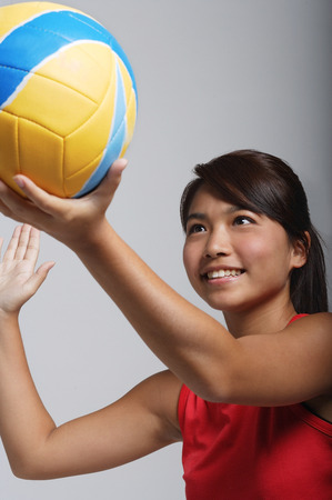 Young woman playing with volleyball Stock Photo