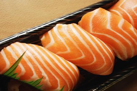 Four pieces of Salmon Sushi, nigiri on rice ball Stock Photo