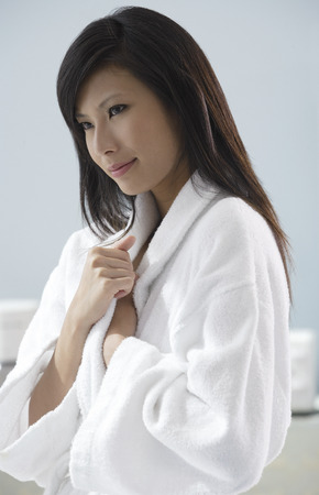 woman bathrobe: woman wearing bathrobe, thinking, relaxed