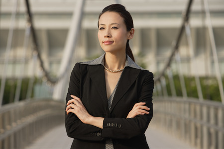 only young women: Businesswoman looking into distance