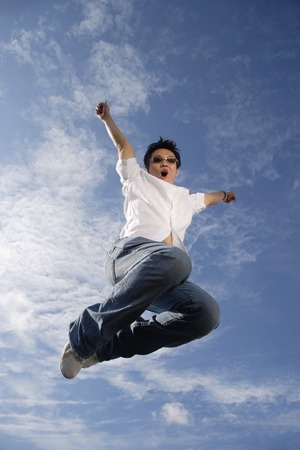 A young man jumps for joy