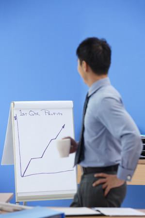 Businessman looking at statistics