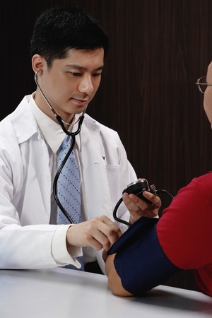 A doctor examines a patient