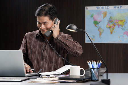 professionally: A man talks on the phone as he works