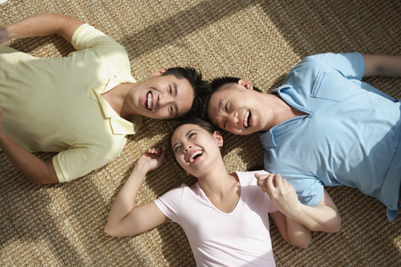 Friends lying on the floor laughing