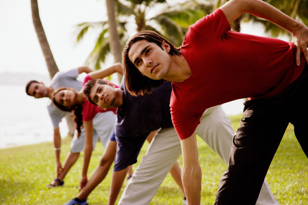 bending: Young adults doing stretching exercises, bending sideways